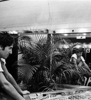 Bruce Springsteen playing a williams lucky ace pinball